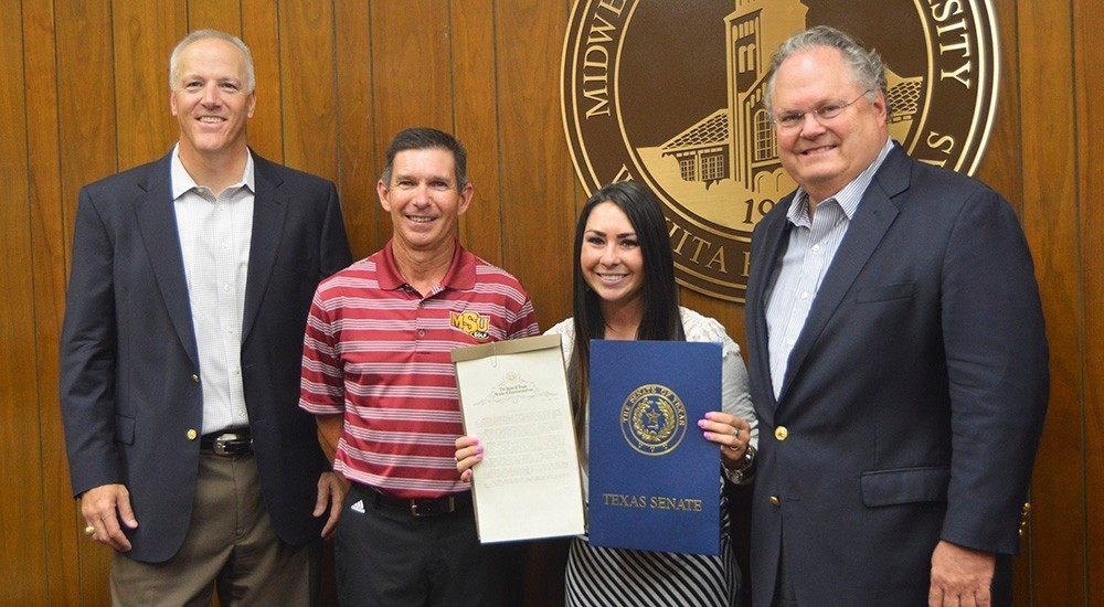 Texas Legislature presents Brenna Moore with resolutions from the senate and house.